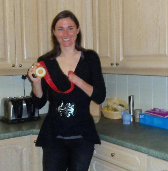Sarah Storey wearing her paralympic gold medal in the kitchen at cornhills farm